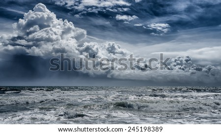 Between the storm and the sunlight - stock photo