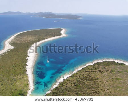 Beutiful bay with sailing boat - island in Adria sea - aerial view