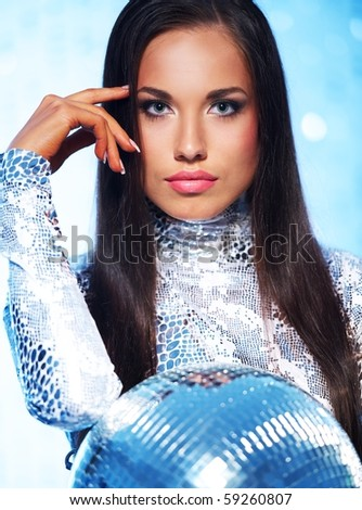Beutiful brunette with disco ball - stock photo