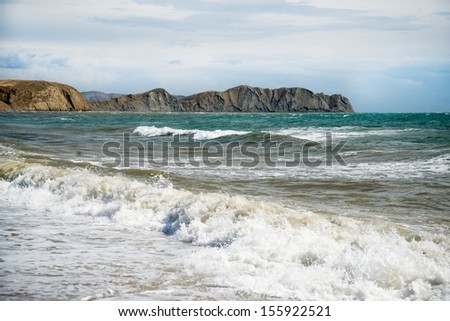 Beutiful ocean waves. Blue sky and clouds - stock photo