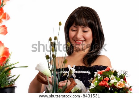 beutiful woman watering plants in whitebackgound