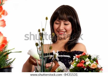 beutiful woman watering plants in whitebackgound - stock photo