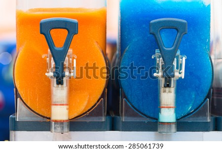 Beverage mixers with yellow and blue cocktails inside. Lithuania. - stock photo