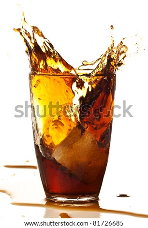 beverage splash into glass on a white background