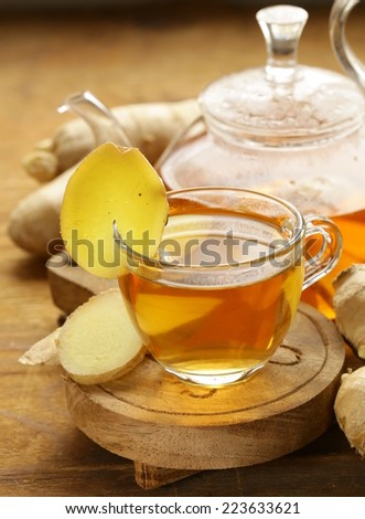 beverage tea with ginger and fresh root on a wooden background - stock photo
