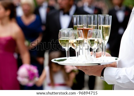 beverages being served by a waiter - stock photo