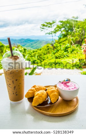 Beverages with fresh croissants on white table, Thailand