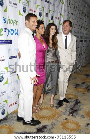 BEVERLY HILLS - APR 17: David Sanders, Halle Berry, Lindsay Jackson, Patrick Delancey at the Silver Rose Awards Gala held at the Beverly Hills Hotel, Beverly Hills, California on April 17, 2011. - stock photo