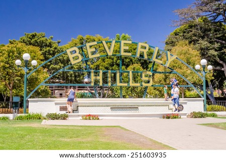 """BEVERLY HILLS - AUGUST 26: Beverly Hills sign on August 26, 2012. Also known by one of its primary ZIP codes, """"90210"""", it has been home to actors and celebrities. - stock photo"""