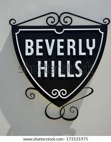 BEVERLY HILLS, CA - AUG 21: Beverly Hills sign, Ca on Aug. 21, 2013. Beverly Hills is world-famous for its luxurious culture and famous residents - stock photo