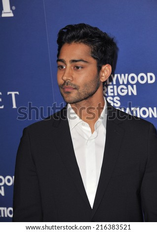 BEVERLY HILLS, CA - AUGUST 14, 2014: Actor Manish Dayal at the Hollywood Foreign Press Association's annual Grants Banquet at the Beverly Hilton Hotel.  - stock photo