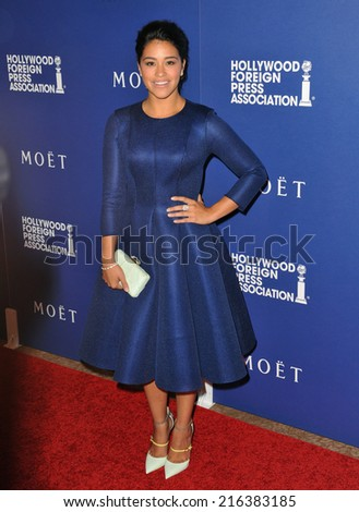 BEVERLY HILLS, CA - AUGUST 14, 2014: Actress Gina Rodriguez at the Hollywood Foreign Press Association's annual Grants Banquet at the Beverly Hilton Hotel.  - stock photo