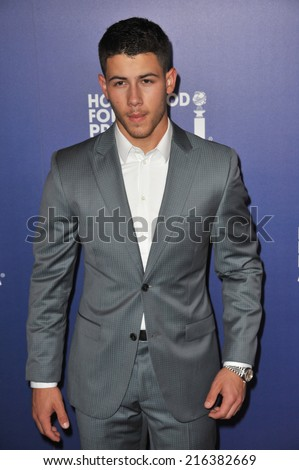 BEVERLY HILLS, CA - AUGUST 14, 2014: Musician Nick Jonas, of The Jonas Brothers, at the Hollywood Foreign Press Association's annual Grants Banquet at the Beverly Hilton Hotel.  - stock photo