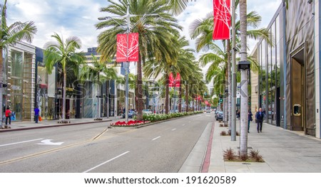 BEVERLY HILLS, CA - DECEMBER 19,2013: Rodeo Drive in Beverly Hills. Rodeo Drive is an affluent shopping district known for designer label and haute couture fashion - stock photo