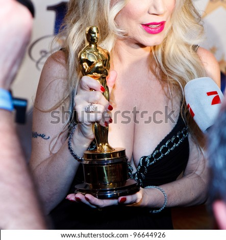 BEVERLY HILLS, CA - FEB. 26: Jennifer Young shows off father Gig Young's Oscar trophy at 22nd Annual Night Of 100 Stars event held at The Beverly Hills Hotel on Feb. 26, 2012 in Beverly Hills, CA. - stock photo
