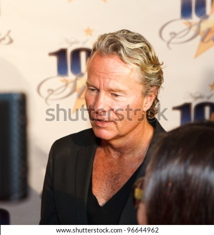 BEVERLY HILLS, CA - FEBRUARY 26: Actor John Savage arrives for Norby Walters' 22nd Annual Night Of 100 Stars event held at The Beverly Hills Hotel on February 26, 2012 in Beverly Hills, California. - stock photo