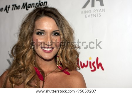 BEVERLY HILLS, CA - FEBRUARY 12: Bikini Girl Katrina Darrell attends the Grammy after party at the Playboy Mansion on February 12, 2012 in Beverly Hills, California. (Photo by Jonathan S. Nowak) - stock photo