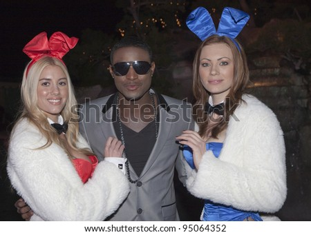 BEVERLY HILLS, CA - FEBRUARY 12: JC Jones poses with the Playboy Bunnies at the Grammy after party at the Playboy Mansion on February 12, 2012 in Beverly Hills, California. (Photo by Jonathan S. Nowak) - stock photo