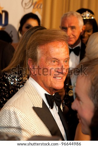 BEVERLY HILLS, CA - FEBRUARY 26: Singer Pat Boone arrives for Norby Walters' 22nd Annual Night Of 100 Stars event held at The Beverly Hills Hotel on February 26, 2012 in Beverly Hills, California. - stock photo