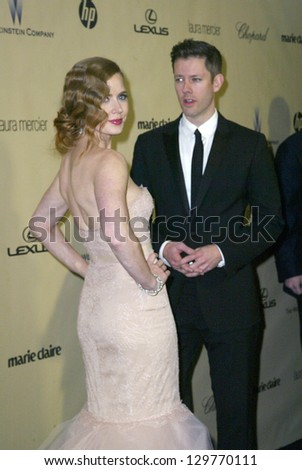 BEVERLY HILLS, CA - JAN. 13: Amy Adams and guest arrive at the Weinstein Company's 2013 Golden Globes After Party on Sunday, January 13, 2013 at the Beverly Hilton Hotel in Beverly Hills, CA. - stock photo