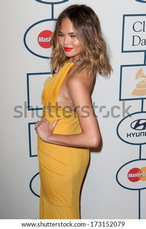 BEVERLY HILLS, CA. - JANUARY 25: Chrissy Teigen arrives at the Clive Davis and The Recording Academy annual Pre-GRAMMY Gala on January 25th 2014 at the Beverly Hilton in Beverly Hills, California. - stock photo
