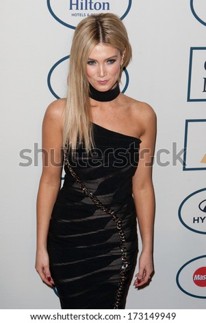 BEVERLY HILLS, CA. - JANUARY 25: Delta Goodrem arrives at the Clive Davis and The Recording Academy annual Pre-GRAMMY Gala on January 25th 2014 at the Beverly Hilton in Beverly Hills, California. - stock photo