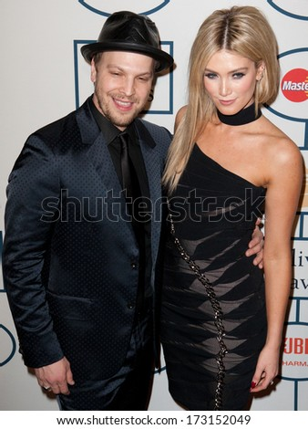 BEVERLY HILLS, CA. - JANUARY 25: Gavin DeGraw & Delta Goodrem arrive at the Clive Davis & The Recording Academy annual Pre-GRAMMY Gala on January 25th 2014 at the Beverly Hilton in Beverly Hills. - stock photo