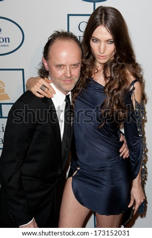 BEVERLY HILLS, CA. - JANUARY 25: Lars Ulrich & Jessica Miller arrive at the Clive Davis & The Recording Academy annual Pre-GRAMMY Gala on January 25th 2014 at the Beverly Hilton in Beverly Hills. - stock photo
