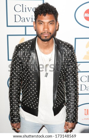 BEVERLY HILLS, CA. - JANUARY 25: Miguel arrives at the Clive Davis and The Recording Academy annual Pre-GRAMMY Gala on January 25th 2014 at the Beverly Hilton in Beverly Hills, California. - stock photo