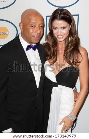 BEVERLY HILLS, CA. - JANUARY 25: Russell Simmons & Shannon Elizabeth arrive at the Clive Davis & The Recording Academy annual Pre-GRAMMY Gala on Jan 25th 2014 at the Beverly Hilton in Beverly Hills. - stock photo