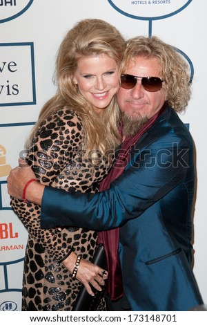 BEVERLY HILLS, CA. - JANUARY 25: Sammy Hagar & wife Kari arrive at the Clive Davis & The Recording Academy annual Pre-GRAMMY Gala on January 25th 2014 at the Beverly Hilton in Beverly Hills. - stock photo