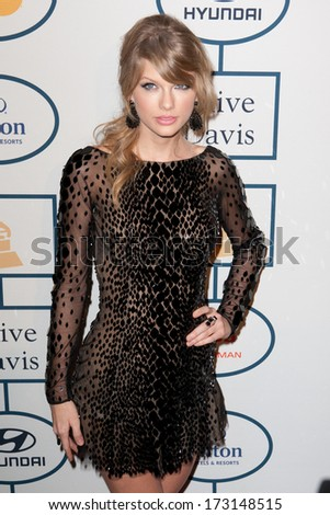 BEVERLY HILLS, CA. - JANUARY 25: Taylor Swift arrives at the Clive Davis and The Recording Academy annual Pre-GRAMMY Gala on January 25th 2014 at the Beverly Hilton in Beverly Hills, California. - stock photo