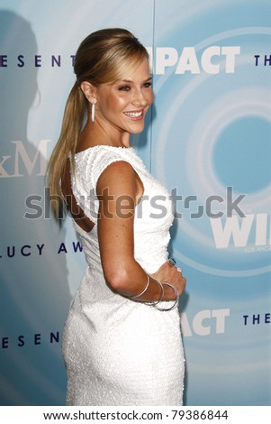 BEVERLY HILLS, CA - JUNE 16: Julie Benz  at the 2011 Women In Film Crystal + Lucy Awards at the Beverly Hilton Hotel in Beverly Hills, California on June 16, 2011.