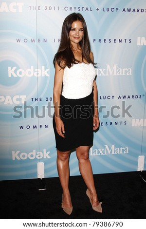 BEVERLY HILLS, CA - JUNE 16: Katie Holmes at the 2011 Women In Film Crystal + Lucy Awards at the Beverly Hilton Hotel in Beverly Hills, California on June 16, 2011. - stock photo