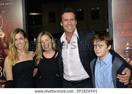 "BEVERLY HILLS, CA - OCTOBER 27, 2015: Actor David James Elliott & wife Nanci Chambers & children at the US premiere of his movie ""Trumbo"" at the Academy of Motion Picture Arts & Sciences - stock photo"