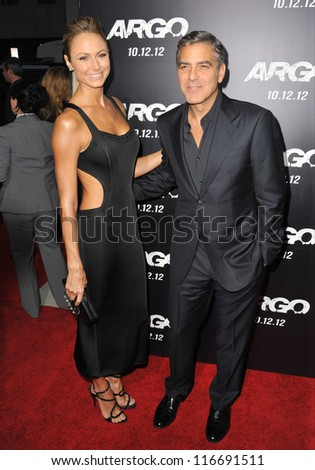 """BEVERLY HILLS, CA - OCTOBER 4, 2012: George Clooney & Stacy Keibler at the Los Angeles premiere of """"Argo,"""" which he produced, at the Samuel Goldwyn Theatre, Beverly Hills. - stock photo"""