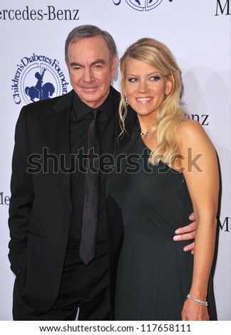 BEVERLY HILLS, CA - OCTOBER 20, 2012: Neil Diamond & wife at the 26th Carousel of Hope Gala at the Beverly Hilton Hotel.