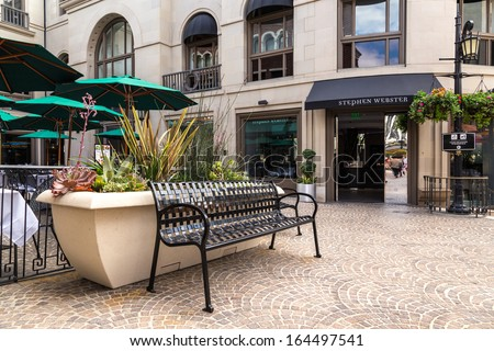 BEVERLY HILLS, CA - SEP 20: Stores in Rodeo Drive, Beverly Hills on September 20, 2013. Rodeo Drive is an affluent shopping district known for designer label and haute couture fashion. - stock photo