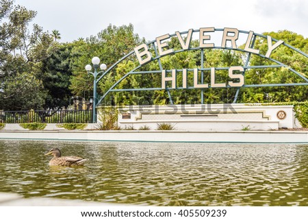 Beverly Hills, CA, USA -  January 16, 2016: Beverly Hills Gardens Park sign in Los Angeles park - stock photo