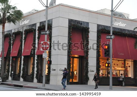 BEVERLY HILLS, CALIFORNIA - DECEMBER 7: Cartier store at Rodeo Drive as seen on December 7, 2012 in Beverly Hills, California. There are more than 100 world-renowned boutiques in this area. - stock photo
