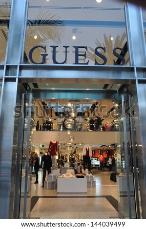 BEVERLY HILLS, CALIFORNIA - DECEMBER 7: Guess store at Rodeo Drive as seen on December 7, 2012 in Beverly Hills, California. There are more than 100 world-renowned boutiques in this area. - stock photo