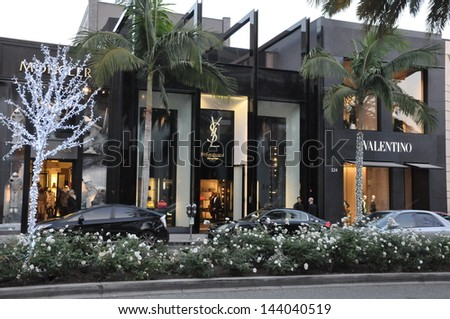 BEVERLY HILLS, CALIFORNIA - DECEMBER 7: YSL & Valentino stores at Rodeo Drive as seen on December 7, 2012 in Beverly Hills, California. There are more than 100 world-renowned boutiques in this area. - stock photo