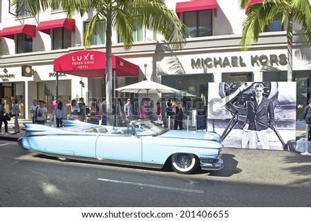 BEVERLY HILLS/CALIFORNIA - JUNE 15, 2014: 1959 Cadillac El Dorado Biarritz Convertible owned by John D'Agostino at the Rodeo Drive Concours D'Elegance on June 15, 2014 Beverly Hills, California, USA  - stock photo