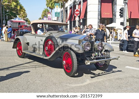 BEVERLY HILLS, CALIFORNIA - JUNE 15, 2014: 1924 Rolls Royce Silver Ghost Picadilly Roadster owned by Greg Gill at the Rodeo Drive Concours D'Elegance on June 15, 2014 Beverly Hills, California, USA  - stock photo