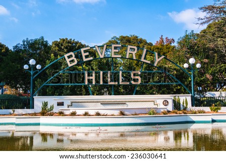 BEVERLY HILLS, CALIFORNIA - NOV 10 2014: A sign indicating Beverly Hills located in a park along Santa Monica Blvd. in Beverly Hills, California. - stock photo