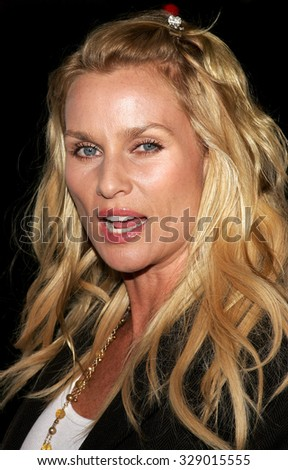 "BEVERLY HILLS, CALIFORNIA. October 10, 2006. Nicollette Sheridan at the World Premiere of ""Running with Scissors"" held at the Academy of Motion Picture Arts and Sciences in Beverly Hills, USA. - stock photo"