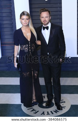 BEVERLY HILLS - FEB 28: Aaron Paul, Lauren Parsekian at the 2016 Vanity Fair Oscar Party on February 28, 2016 in Beverly Hills, California - stock photo