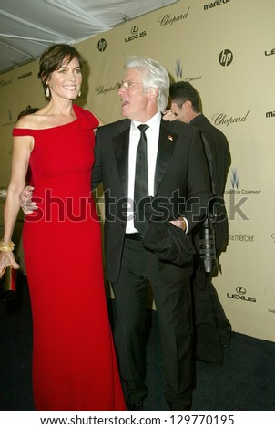BEVERLY HILLS - JAN. 13: Carrie Lowell & Richard Gere arrive at the Weinstein Company's 2013 Golden Globes After Party on Sunday, January 13, 2013 at the Beverly Hilton Hotel in Beverly Hills, CA. - stock photo