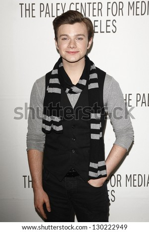 BEVERLY HILLS - MAR 16:  Chris Colfer arriving at the 2011 PaleyFest honoring 'Glee' held at the Saban Theater in Beverly Hills on March 16, 2010. - stock photo