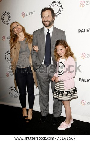 BEVERLY HILLS - MAR 12:  Leslie Mann, Judd Apatow, daughter Iris arriving at the Paleyfest 2011 event honoring Freaks and Geeks/Undeclared in Beverly Hills, California on March 12, 2011. - stock photo